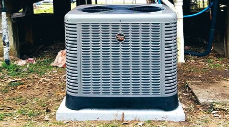 Replace that tired old air conditioner with a new system, like the one in this image.