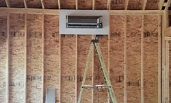 This is an image of a Mitsubishi cassette installed in a new construction