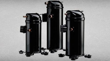 This is an image of 3 brand new ac compressors