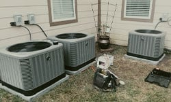 This is an image of another beautiful Delta T Heating and Cooling install, this is a trio of Ruud Ultra series A/C's