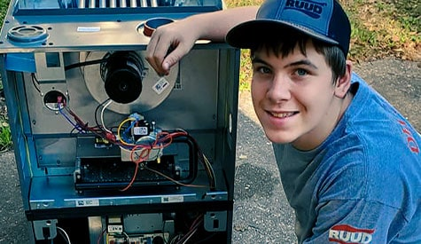 It's important to thoroughtly check your AC system, repair where you can, and replace when you need to, like in this image of Travis Elliot's son replacing a furnace